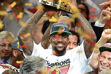 LeBron James of the Miami Heat holds the championship trophy after defeating the Oklahoma City Thunder in Game 5 of the NBA Finals.