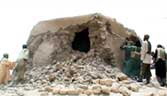 A still from a video shows Islamist militants destroying an ancient shrine in Timbuktu on July 1, 2012. Islamist rebels in northern Mali smashed four more tombs of ancient Muslim saints in Timbuktu on July 1.