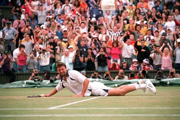 Goran Ivanisevic is overcome with emotion after becoming the Mens Singles Champion, despite being a wild card entry, 2001