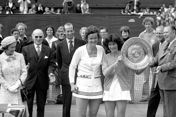 Virginia Wade holding the trophy she won after defeating Holland's Betty Stove in the finals at Wimbledon. The trophy was presented by Queen Elizabeth II, 1977