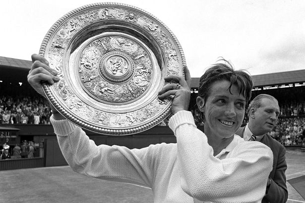 Margaret Court holds the Ladies Singles Plate after beating USA's Billie Jean-King, 1970