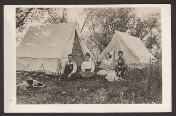 John Nelson's photograph of two couples seated in front of their tents was taken sometime between 1907 and 1917. NSHS RG3542-98-4