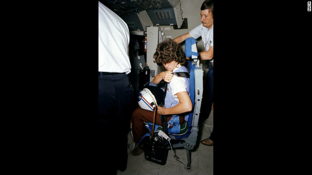 A technician helps Ride strap herself into the shuttle mission simulator in Houston on May 23, 1983, less than a month before her launch.