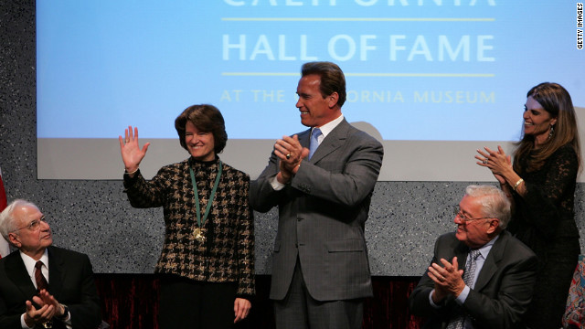 California Gov. Arnold Schwarzenegger applauds Ride after inducting her into the California Hall of Fame on December 6, 2006, in Sacramento, California.