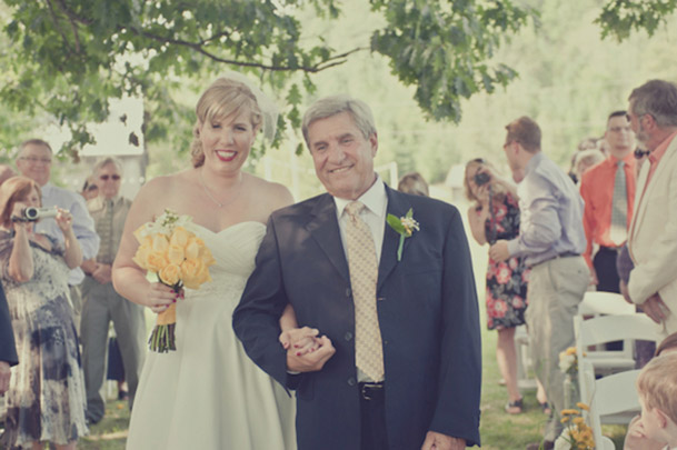 father daughter down aisle yellow