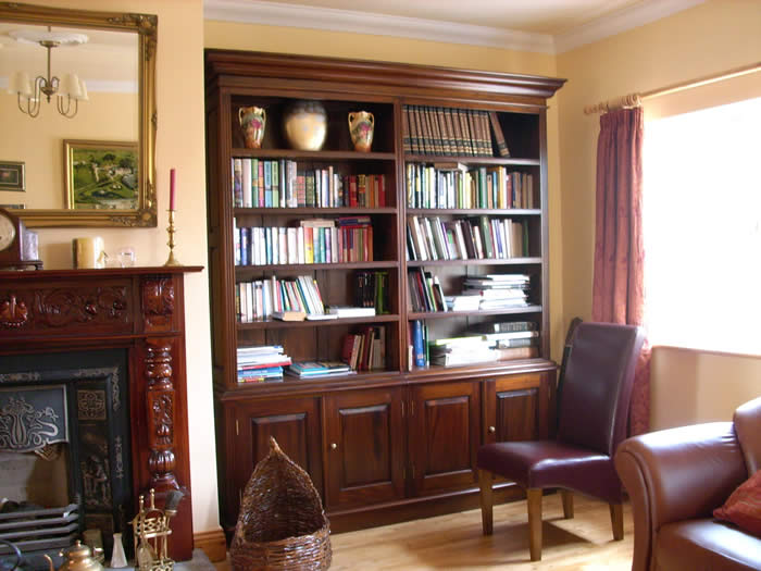 bookcase in the sitting room at Dan O' Hara Farmhouse B&B Clifden