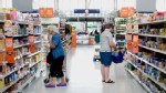 PHOTO: Customers browse the bread aisle in a supermarket.