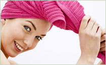 Women with hair wrapped in towel