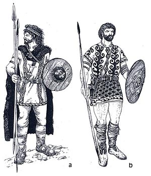 Figure 43. Celtic 'warriors' from northwestern and northern Iberia. A: with spears and 'Monte Bernorio-type' dagger, gold torque, fibulae, caetra, and bronze belt plate. Details for the boots have been taken from a ceramic votive piece. B: with spear, bi-globular dagger and caetra (small round shield). Adornments are taken from warrior stone sculptures. (After Álvarez Peña 2002).