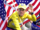 This July 23, 2000 file photo shows Tour de France winner Lance Armstrong riding down the Champs Elysees with an American flag after the 21st and final stage of the cycling race in Paris.