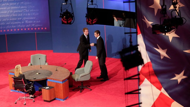 PHOTO: Students posing as Vice President Joe Biden, and Republican vice presidential candidate, Rep. Paul Ryan, R-Wis., shake hands during set up for Thursday's vice presidential debate, Oct. 10, 2012, at Centre College in Danville, Ky.