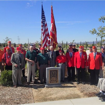 """Photo: The California Delta Chapter, 1st Marine Division Association dedicated one of the first upright monuments on the Sacramento Valley National Cemetery Memorial Walk in a ceremony on Sept. 8. The monument reads: """"1st  Marine Division Association – Semper Fidelis – Dedicated to those men of the 1st  Marine Division, FMF who gave their lives in the service of their country – World War II – Korea – Vietnam – Southwest Asia.""""   The bronze plaque is emblazoned with a wreath, the number one and symbols of the US Marine Corps.  Cemetery director Cynthia Nunez said, """"We thank you for this wonderful addition to our memorial walk. We hope you will come and visit us often to pause, reflect and honor our Veterans."""""""