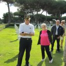 Photo: 90-year-old World War II Veteran Arthur Unruh saluted his fallen comrades during a visit to Sicily-Rome American Cemetery. Accompanied by his wife, Col. Chris Cook, USAF Attaché, and several friends, the group received a personal tour of the cemetery with stops at the visitor's center, memorial, Brothers-in-Arms statue, chapel, and plot areas.    Unruh, a waist gunner for the 32nd Bomb Squadron, 301st Bomb Group, arrived in Italy in early 1944 and his plane dropped the first bombs on the abbey at Montecassino. Eighteen men from the 32nd Squadron are buried or memorialized at Sicily-Rome American Cemetery  Unruh visited these gravesites, and saluted his fallen comrades one final time to say goodbye.