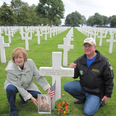 """Photo: Kathy Hight, niece of William H. Dukeman, Jr., and her husband Arthur visited Netherlands American Cemetery to honor her uncle. Dukeman is one of the three """"Band of Brothers"""" buried at Netherlands American Cemetery."""