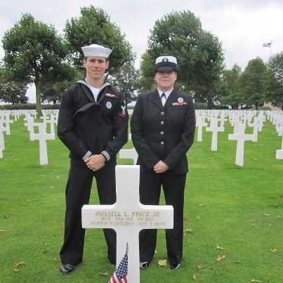 Photo: Petty Officer Clinton T. Hobbs, accompanied by Petty Officer Jamie N. Morgan, visits the grave of his great uncle Pvt. Russell L. Price, Jr. at Netherlands American Cemetery.