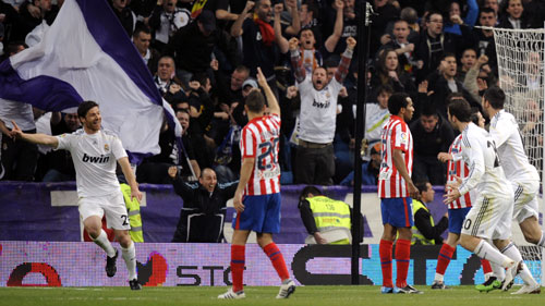 Xavi Alonso celebrates his goal in the Madrid derby