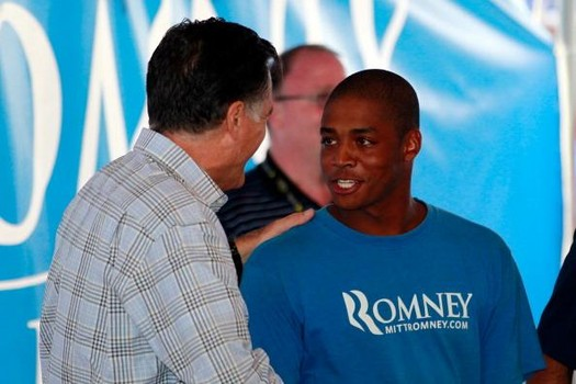 Republican presidential candidate, former Massachusetts Gov. Mitt Romney shakes hands with a NASCAR fan during a rain delay before the start of the NASCAR Sprint Cup Series Federated Auto Parts 400 at Richmond International Raceway on September 8, 2012.