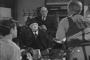 George Bailey and his father confront Mr. Potter