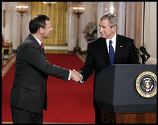 After introducing John G. Roberts Jr., President Bush turns to his nominee to the Supreme Court to congratulate the appellate court judge.