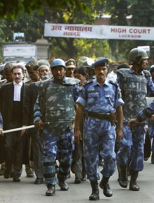 Securitymen escort lawyers coming out of the Lucknow Bench of the Allahabad High Court after the Ayodhya verdict, in Lucknow on Thursday.