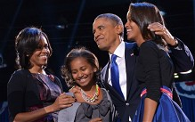 US President Barack Obama, accompanied by his wife Michelle and daughters Sasha and Malia, on stage at his election night party in Chicago, Illinois.