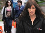 She looks purr-fect! Emmy Rossum dons leopard print top on movie set... while Hilary Swank wears unflattering raincoat
