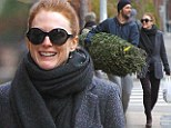 Christmas cheer! Julianne Moore and husband Bart Freundlich pick up a tree in time for the holidays