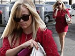 She means business! Lady in red Reese Witherspoon displays her slim post-pregnancy figure in a short dress as she heads to a meeting