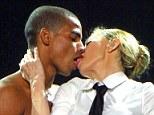 Raunchy: Madonna puckered up to her toyboy lover, Brahim Zaibat, on stage in Brazil