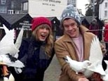 Swan-tastic: Taylor Swift and Harry Styles get to grips with the locals in Bowness