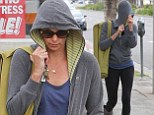 Charlize was in a shy mood and covered her new short hairstyle with her hoody