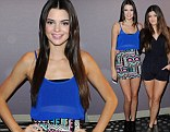 Model sisters: Kendall Jenner shows off her long legs in a mini-skirt, while sister Kylie is stylish in a black playsuit as they attend charity photocall