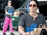 That's so Pink! Singer goes food shopping but looks downcast despite her cheery trousers