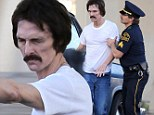 Stop in the name of the law! Gaunt Matthew McConaughey is unrecognisable as he is led away by police for Dallas Buyers Club scene