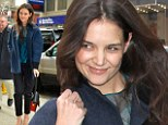 It's a shame you can't show it off! Katie Holmes looks glamorous in stylish outfit for interview... on the radio