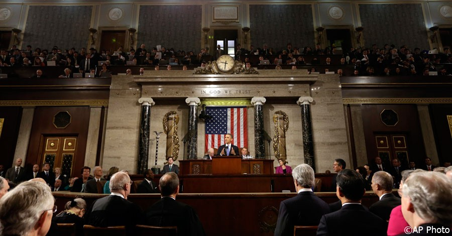 President Barack Obama, flanked by Vice President Joe Biden and House Speaker John Boehner of Ohio, gives his State of the Union address during a joint session of Congress on Capitol Hill in Washington, February 12, 2013. [AP Photo]