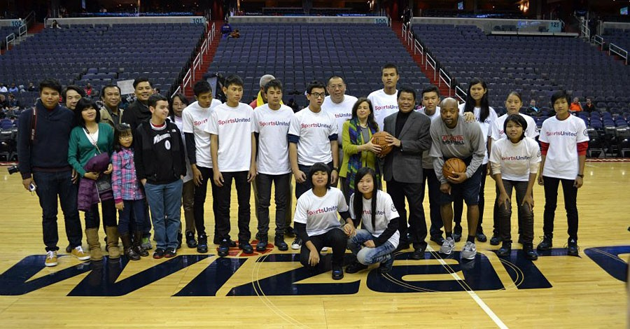 Under Secretary of State for Public Diplomacy and Public Affairs Tara D. Sonenshine and Ambassador Than Swe pose for a photograph with Burmese youth participating in a SportsUnited exchange program at the Verizon Center in Washington, D.C., January 8, 2013. [State Department photo/ Public Domain]