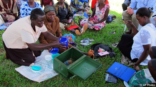In this April 4, 2012 photo, women affected by AIDS share stories of survival at the Reach Out clinic on the outskirts of Kampala, Uganda. The clinic receives money from the U.S. President's Emergency Plan for AIDS Relief, or PEPFAR. [AP File Photo]