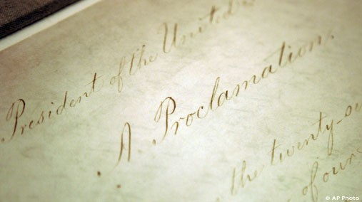 This Feb. 18, 2005 file photo shows the original Emancipation Proclamation on display in the Rotunda of the National Archives in Washington. [AP File Photo]