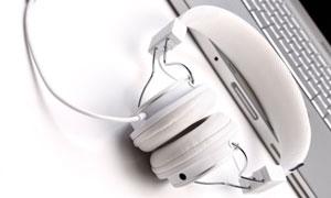 White headphones and laptop