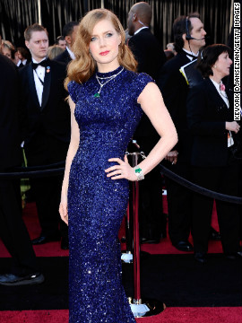 """In 2011, the year Amy Adams was nominated for her role in """"The Fighter,"""" she paired her navy blue L'Wren Scott gown with emerald and diamond jewels."""