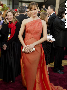 """Jennifer Garner wore a memorable tangerine gown at the 2004 Academy Awards. """"Jennifer is so comfortable in her own skin, she can wear a gown this complex,"""" designer Valentino said."""