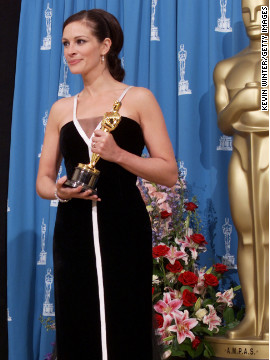 """In 2001, Julia Roberts accepted her Oscar for """"Erin Brockovich"""" wearing a black and white vintage Valentino gown."""