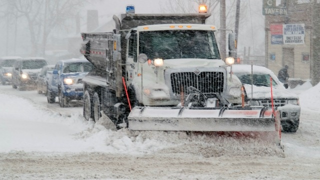 Snow plow during storm - Photo by FEMA/Michael Rieger