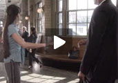 """Screenshot of woman in train station from """"If You See Something, Say Something"""" PSA"""