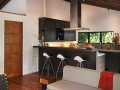 Interior and kitchen at Modern Home Design with Rustic Wooden ceiling and Floor