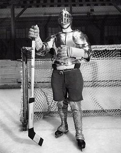 """""""The White Knight of Hockey Arms for the Fray"""": Goalie Emmet Venne, of the Seattle Seahawks (formerly of the Detroit Olympics), entered the rink for a 1933 exhibition game wearing more than the usual protection. Photo: The New York Times"""