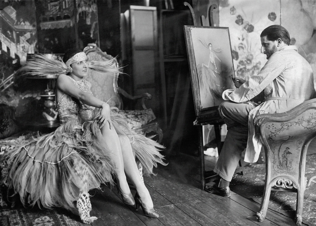 """June 28, 1926: """"The Painter and the Inspiration: Dora Duby,"""" an American dancer, posing for Jean Gabriel Domergue in his studio in Paris — not the only instance of artists with with their muses in The Times's Lively Morgue. Photo: The New York Times"""