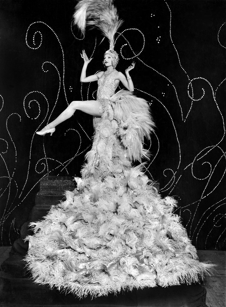 """Aug. 20, 1925: Claire Luce, a famous American dancer, donned the """"famous feather costume of Mistinguett,"""" a famous French dancer, in Paris. Photo: The New York Times"""
