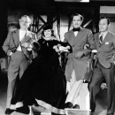 Frank Morgan, Rosalind Russell, Robert Montgomery and director J. Walter Ruben on the set of <em>Trouble for Two</em>